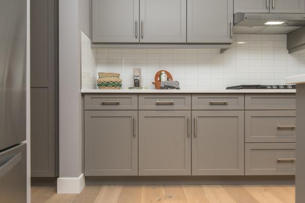 beautiful-shot-modern-house-kitchen-shelves-drawers_181624-2941